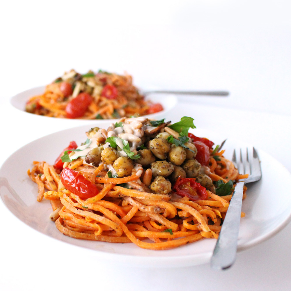 These Mediterranean sweet potato noodles are a vegan, gluten-free dish topped with zaatar roasted chickpeas, burst tomatoes, and a creamy tahini sauce. This plant based recipe makes a healthy, simple meal.